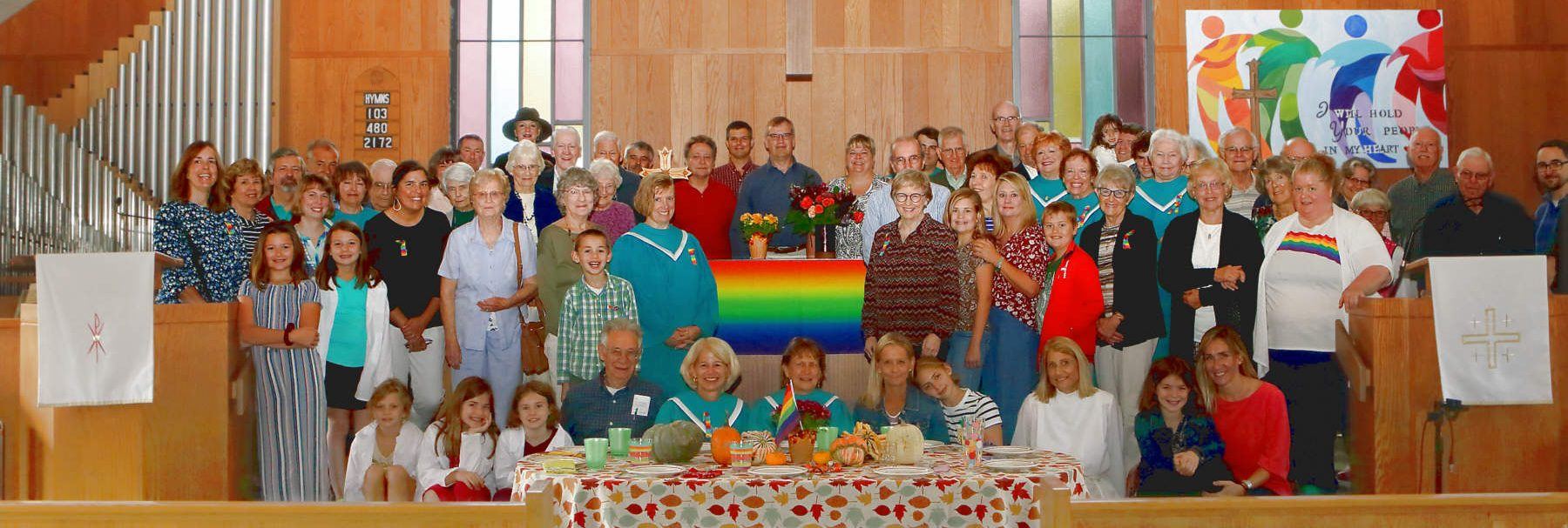 Photo of some of the Congregation gathered around thee communion table in fall 2019. Lansing United Methodist Church became a Reconciling Congregation on September 22, 2019.